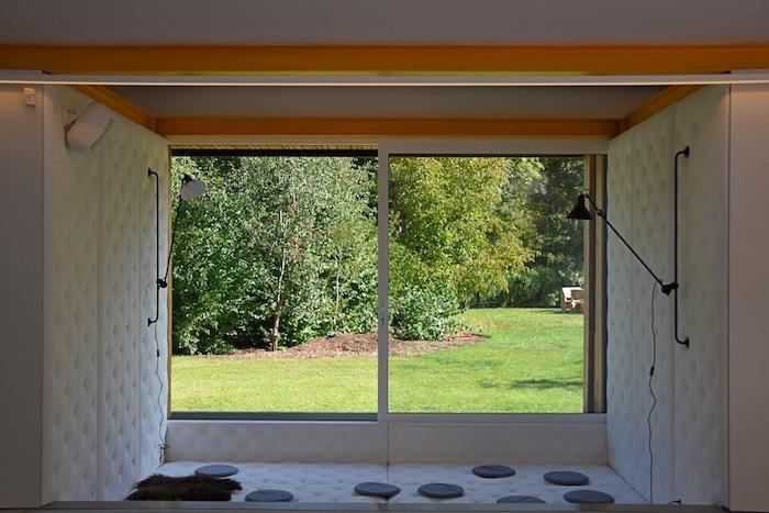 Creative break-out ruimte Perspective met zicht op de tuin om zelfs binnen te vergaderen in de natuur